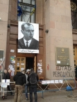 A portrait of Nazi collaborator Stepan Bandera hanging over the entrance to Kiev city hall.